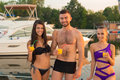 Guy With  Girls At The Yacht Club. Royalty Free Stock Images - 59044469