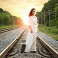 Young Alone Woman Standing With Suitcase On Railroad Stock Photos - 59067823