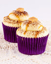 Two Caramel Cupcakes In Purple Papers Royalty Free Stock Image - 59094326