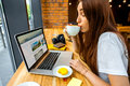 Woman Working Online With Coffee Cup Stock Photo - 59113160
