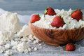 A Bowl With Some Cottage Cheese And Strawberries Stock Images - 59146304