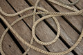 Braided Rope On Wood Deck Royalty Free Stock Photo - 59172455