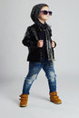 Funny Child.fashionable Little Boy In Sunglasses.stylish Kid In Yellow Shoes Royalty Free Stock Image - 59220566