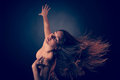 Young Brunette Caucasian Woman Dancing And Her Hair Flowing Through The Air Royalty Free Stock Photography - 59224087