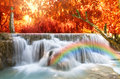 Beautiful Waterfall With Soft Focus And Rainbow In The Forest Stock Photos - 59224953