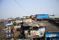 India, Mumbai - November 19, 2014: Dharavi Slum Rooftops Taken From The Bridge Over The Railway Line To The Left. Stock Photos - 59229013
