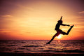 Happy Teen Girl  Jumping On The Beach Royalty Free Stock Images - 59242099