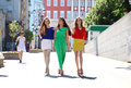 Three Beautiful Young Women Girlfriends Walk On A Summer Street Royalty Free Stock Photos - 59292308