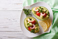 Avocado Filled With Shrimp Salad And Vegetables. Horizontal Top View Stock Images - 59311814