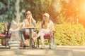 Girlfriends Enjoying Cocktails In An Outdoor Cafe, Friendship Concept Stock Photo - 59442240