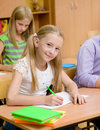 Portrait Of A Happy Girl Who Writes In A Exercise Book During The Exam Royalty Free Stock Image - 59449246