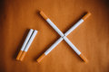World No Tobacco Day : Cigarette Put On Brown Table Showing Sign No Smoking Royalty Free Stock Images - 59459959