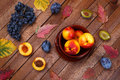 Top View Of The Harvest Peaches, Grapes And Plums Stock Photo - 59501760