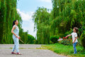 Mother And Son Playing Badminton In The Park Stock Photos - 59508643