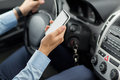 Close Up Of Man Hand With Smartphone Driving Car Stock Photography - 59513292