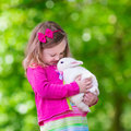 Little Girl Playing With Rabbit Stock Photography - 59531232