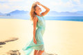 Blonde Girl In Azure Looks Forward Wind Shakes Hair On Beach Royalty Free Stock Images - 59537089