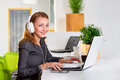 Young Successful Businesswoman In Headphones With Laptop Computer Surfing The Internet At Modern Bright Office. Woman Using Tablet Royalty Free Stock Photos - 59541178