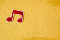 Music Note Plastic Sticker On Colorful Cement Wall Stock Images - 59558524