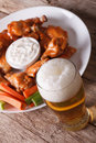 American Fast Food: Buffalo Wings And Beer Close-up Vertical Stock Photos - 59562203
