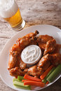Buffalo Wings And Beer On The Table Close-up Vertical Royalty Free Stock Image - 59564696