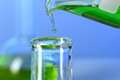 Liquid Pouring From Flask Into Test Tube Royalty Free Stock Photo - 59578045