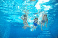 Family Swim In Pool Or Sea Underwater, Mother And Children Have Fun In Water Stock Photography - 59587772