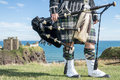 Traditional Scottish Bagpiper In Full Dress Code At Dunnottar Castle Stock Images - 59588424