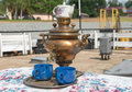Ancient Copper Samovar On The Pier To Meet Guests Royalty Free Stock Images - 59595779