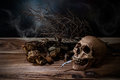 Still Life Smoking Human Skull With Cigarette On Wooden Table Stock Photo - 59596220