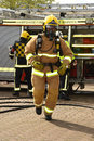 Firefighters In Breathing Apparatus On The Move Stock Images - 59599614