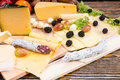 Gourmet Cheese Board With Cured Meat And Fruit Stock Photos - 59615143