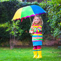Little Girl Playing In The Rain Under Colorful Umbrella Stock Images - 59615884