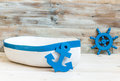 Little Toy Boat With Anchor And Helm Royalty Free Stock Photo - 59627755