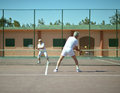Senior Couple On Tennis Court Royalty Free Stock Photo - 59631245