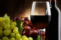 Composition With Glass, Bottle Of Red Wine And Fresh Grapes Royalty Free Stock Images - 59664509