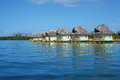 Caribbean Overwater Bungalows With Thatched Roof Stock Photos - 59683593
