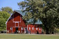 Old Red Hip Roofed Barn Royalty Free Stock Photo - 59691385