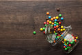 Overturned Glass Jar Full Of Colorful Sweets Stock Images - 59708434