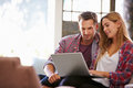 Couple At Home In Lounge Using Laptop Computer Stock Photo - 59723570