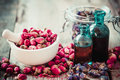 Mortar With Rose Buds, Bottles Of Tincture And Dried Flowers Royalty Free Stock Photos - 59731268