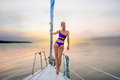 Girl Stands On The Nose Of The Yacht And Looking At The Sunset. Stock Images - 59738444