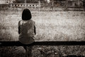 Sad Asian Girl Sitting Alone Stock Image - 59752191