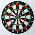 Four Darts On A Bullseye. Stock Image - 59755311