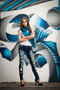 Fashionable Woman With Blured Graffitti In Background Stock Image - 59805901