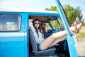 Smiling Young Hippie Women Resting Minivan Car Royalty Free Stock Image - 59816396