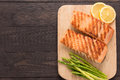 Grilled Salmon And Lemon, Asparagus On The Wooden Background Royalty Free Stock Photo - 59819345