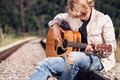 Railway Blues. Young Man Plaing On Guitar On The Railway Royalty Free Stock Photos - 59820058