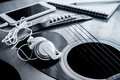 Close Up Of Earpiece With Cellphone On Guitar Stock Images - 59829464