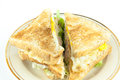 Sandwich Full Of Tuna And Lettuce Vegetables Sliced In Half And Decorated On The Plate - Closeup. Royalty Free Stock Photography - 59857417